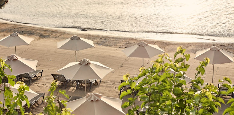 Minos Palace, parasols on private beach