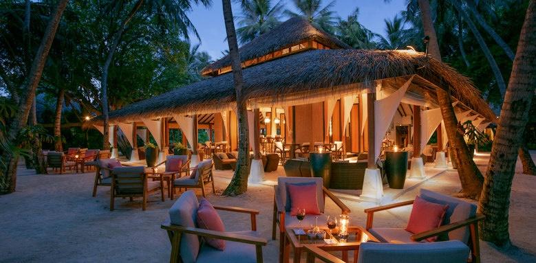 Baros Maldives palm garden twilight