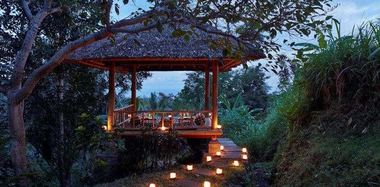 Amankila, night scene with fairy lights on a thatched gazebo