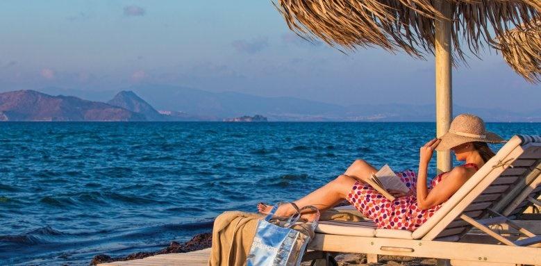 Aqua Blu Boutique Hotel & Spa, woman on beach sunlounger