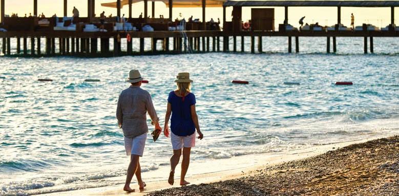 Gloria Serenity Resort, couple on beach at sunset