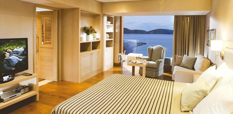 Elounda Bay Palace, deluxe hotel suite sea view bedroom