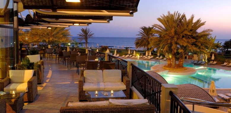 Constantinou Bros Athena Beach Hotel, veranda at night