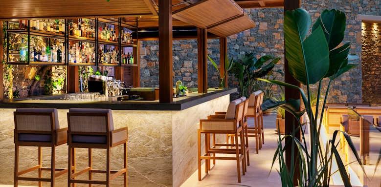 Daios Cove Luxury Resort & Villas, bar at night