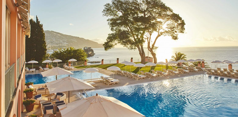 belmond reids palace, pool at sunset