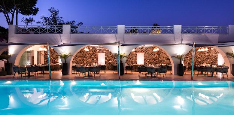 Santorini Kastelli Resort, pool and restaurant at night time