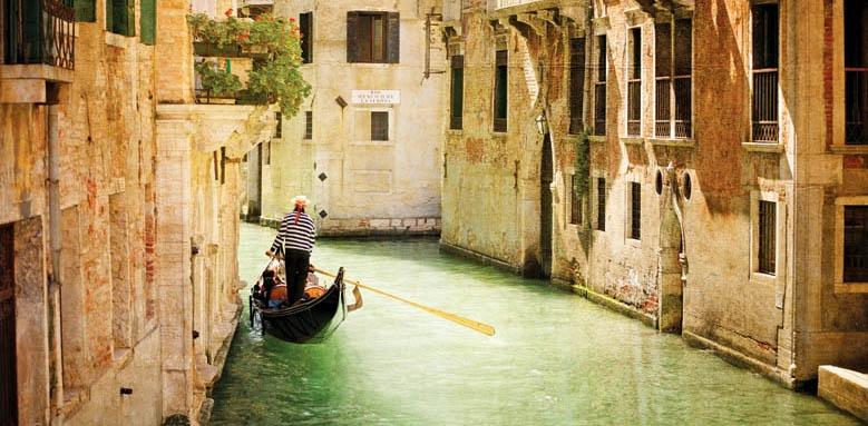 San Clemente Palace Kempinski Venice, gondola on small canal