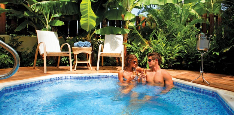 Sugar Cane Club Hotel & Spa, Couple enjoying pool