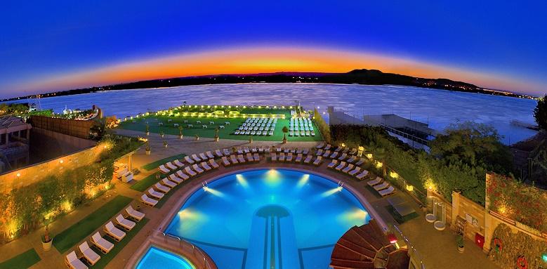 Sonesta St George Hotel, pool and pontoon at night