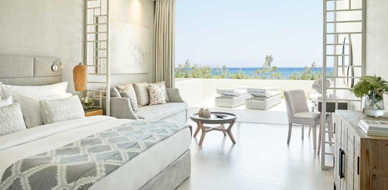 ikos aria, junior suite private garden with sea view