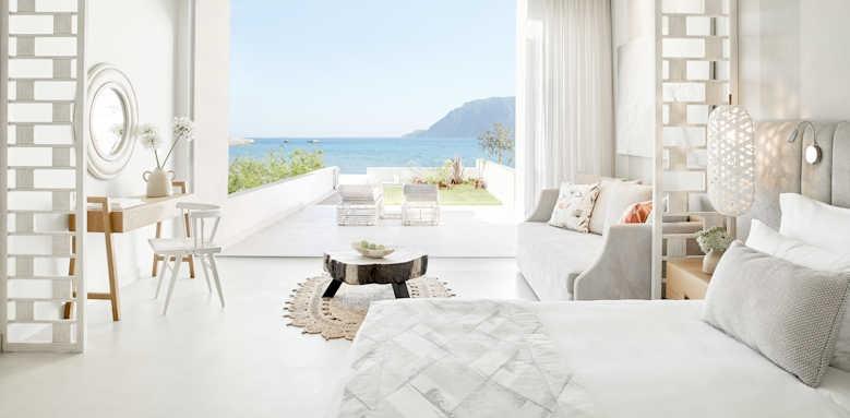 ikos aria, deluxe junior suite private garden sea view